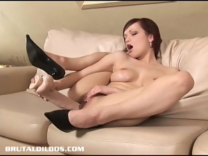 Short haired babe devouring a huge dildo with her pussy