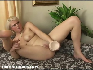Armani St James stretches her pussy with a huge dildo