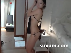 Cute Asian girl stripping naked
