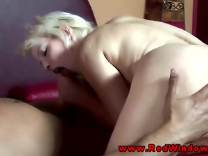 A sexy brunette giving cocksuck to an old man