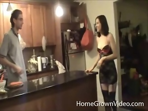 Lingerie girl seduces her man in the kitchen