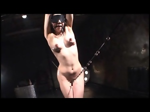 Gagged and blindfolded Japanese girl coated in oil