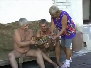 Old guys undress granny chick outdoors