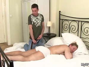 Muscular sleeping guy gets a blowjob