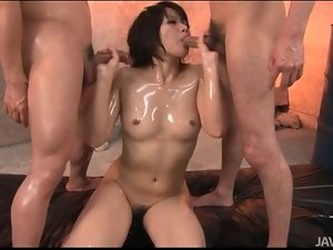 Coated in sexy oil and fucking in threesome