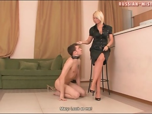 Girl in heels walks over the submissive guy