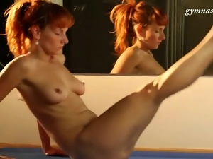 Flexible redhead bends naked body solo