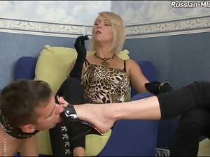 He licks the feet of sexy femdom girls