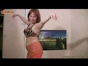 Busty drunk girl in bra does belly dance