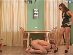 Mistress puts him on a leash and tramples