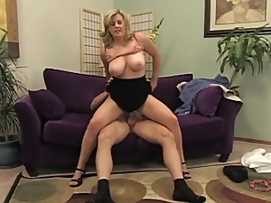 Curvy blonde with big titties rides a dick