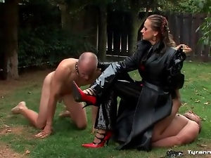 Mistress smokes cigar and uses guy as an ashtray