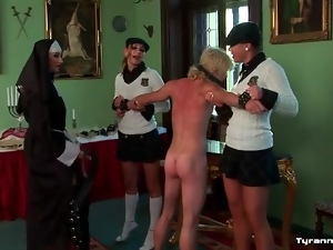 Schoolgirls and nun flog the bound man