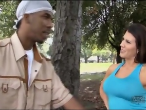 Sporty milf gives black guy a lap dance outdoors