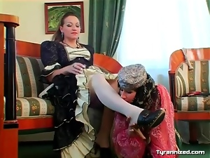 Belly dancing girl licks her mistress for pleasure