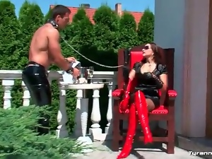 Licking mistress in leather boots and skirt all over
