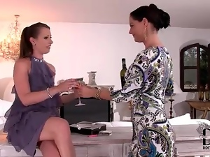 Two women in dresses and sexy shoes fool around