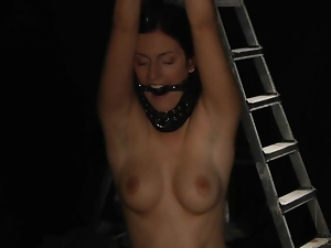 Young stunning Mira in a slave trap