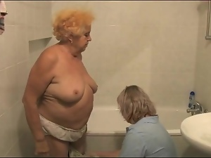 Granny gets a bath from her nurse