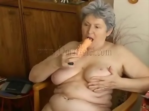 Big tits granny turns on her hole with dildo