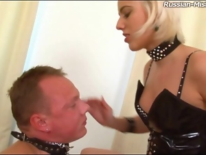 Latex corset and heels on abusive mistress