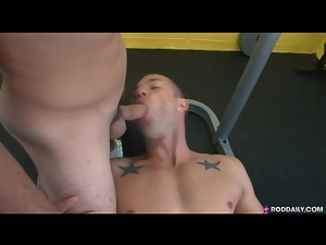 Three dudes in the gym have oral and anal sex