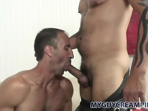 Muscular daddy fucks load into him