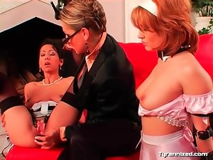Sexy mistress has two sub girls having toy sex