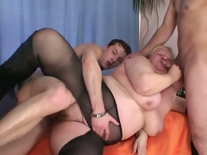 Busty granny and two young cocks