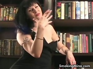 Naughty brunette milf smokes and provokes