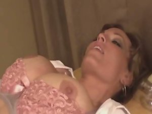 Milf with massive jugs masturbates