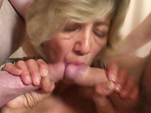 Mature lady tag teamed by two studs