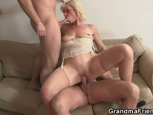 Mature lady banged by two guys