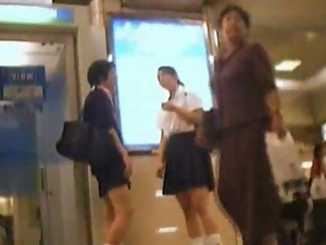 Upskirt view of asian schoolgirls