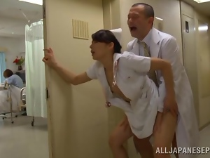 Horny nurse's fucked by a doctor in a hospital hallway