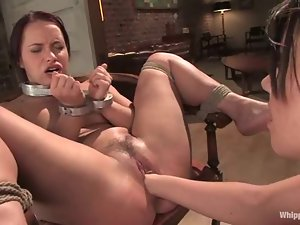 A BDSM scene of a hot brown-haired bitch enjoying fisting