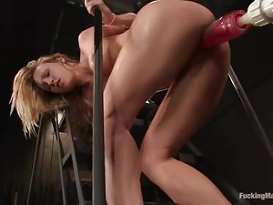 Lusty blond spreads her legs for a fucking machine