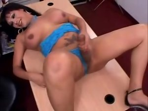 Nasty shemale is jerking off in her office