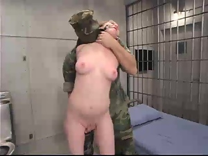 Military prisoner is being tortured by two officers