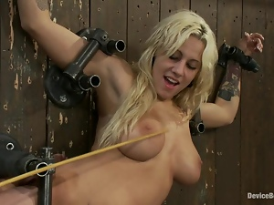 Lylith Lavey gets chained to a wall and fucked by a sex machine