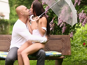 Sexy brunette's fucked on a park bench