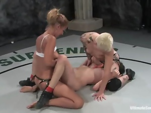 A few busty lesbians play with each other's vags during a fight