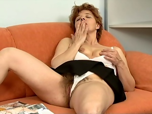 Mature skank Rose smashes her hairy pussy with a realistic dildo