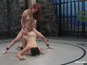 Tattooed brunette gets fucked by a redhead during a battle on tatami