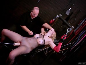 Tied up Emma Ash gets her pussy toyed by a machine