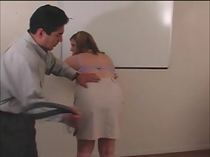 Chubby teacher Haley gets spanked by her colleague in a classroom