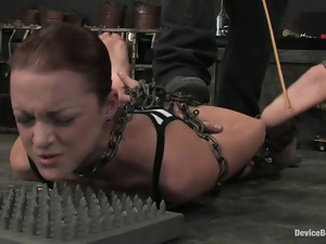Chained Sara Faye gets her tits and pussy tortured