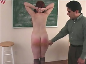 Redhead hussy Anna gets her ass spanked till it gets red