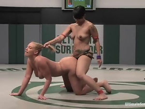 DragonLily fucks Mellanie Monroe during a battle on tatami