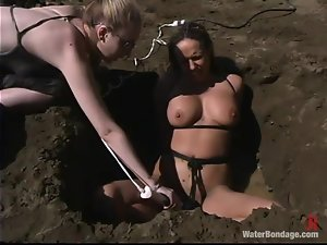 Sasha Sparks gets tortured and fucked with a dildo outdoors